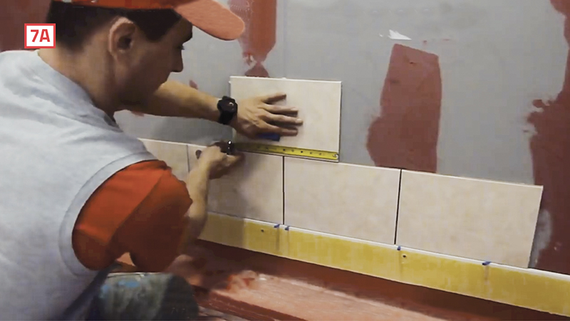 check the level at every course during the shower tile install