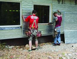 installing rigid foam insulation on home exterior