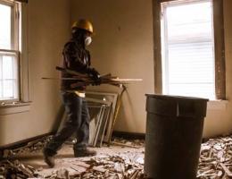 Plaster demolition worker