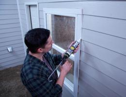 Application of Quad Max caulk to an exterior window.