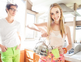 Millennial homeowners looking happy in bright kitchen