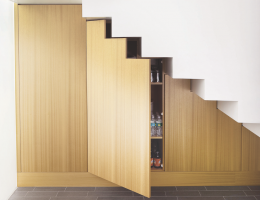 under-stair storage designed and built into the structure