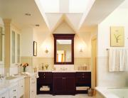 In this bathroom for a master suite addition to a Tudor-style home, most of the daylight comes from two north-facing skylights.