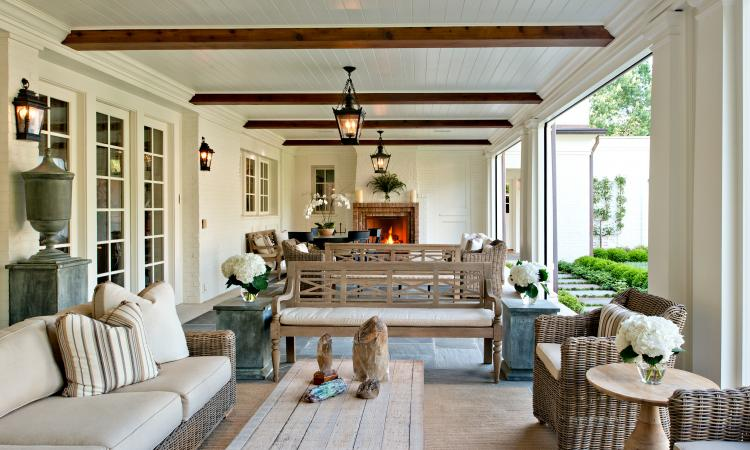 A new porch overlooking the grass courtyard serves as the homeowner's primary en