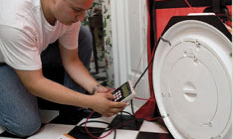 Testing the airtightness of a home using a special fan called a blower door.
