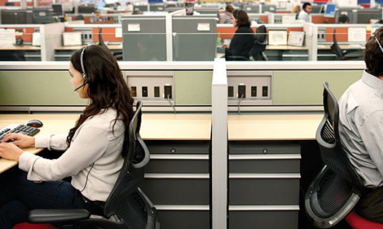 Call center workers at desks