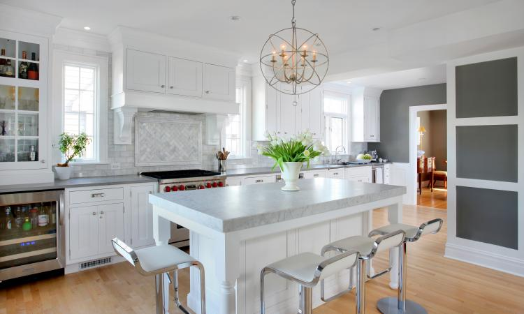 A 78-inch long, 36-inch high island outfitted with granite countertop and built-