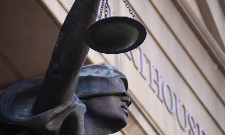 scales of justice outside the courthouse