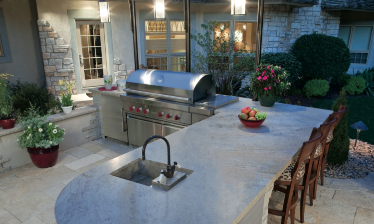 An outdoor kitchen is often planned next to or close to the kitchen of the house