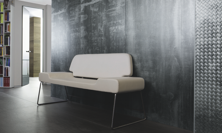 Industrial chic and reclaimed materials, such as the Metalli collection by Laminam