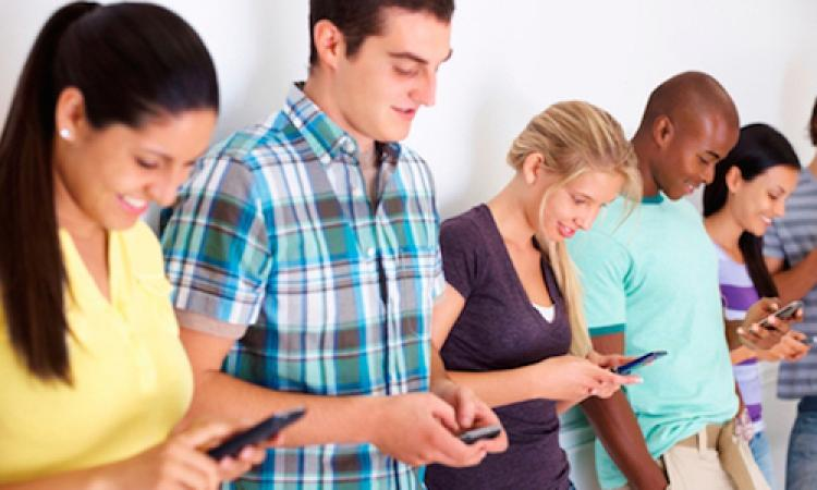 Group of youths communicating via text message