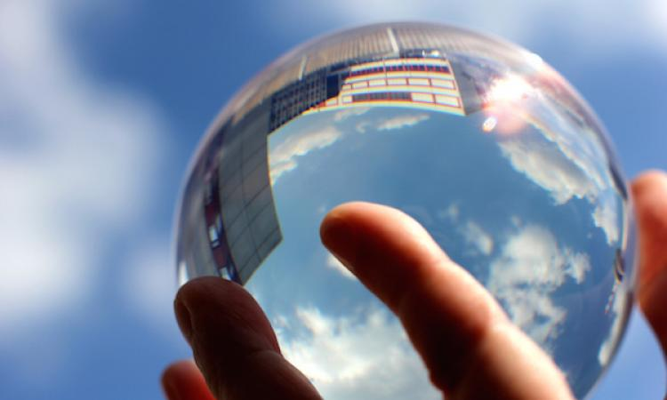 Predicting the future with a crystal ball.