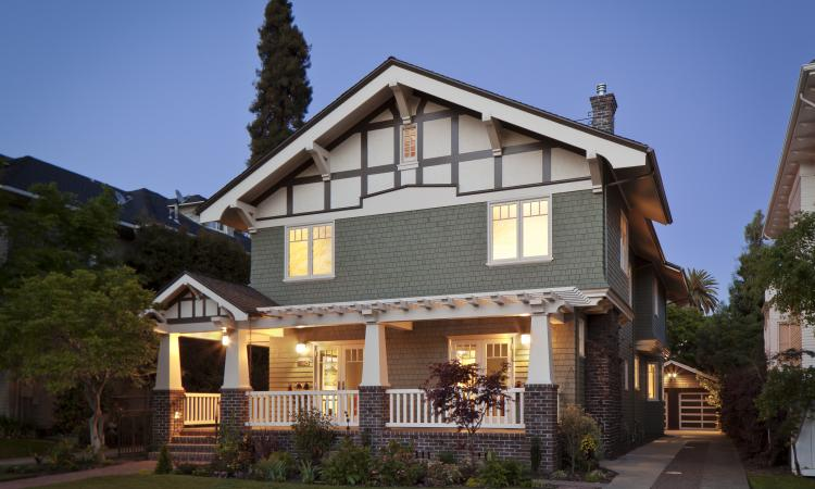 A new front porch and terrace with French doors were added to create a warm, wel