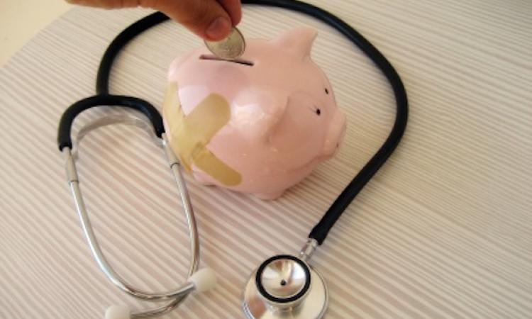 Piggy bank and stethoscope denote health insurance costs rising.