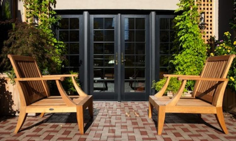 M.R.S. used black exterior frames on the new Andersen windows to match the facad
