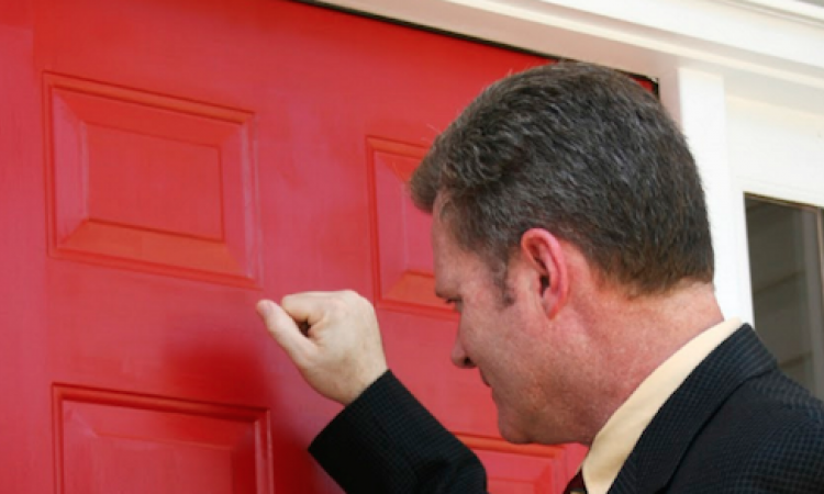 Salesman knocking on door for home improvement sales appointment