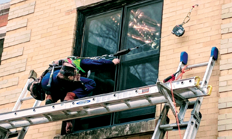 remodeling installing home run-proof windows from Pella