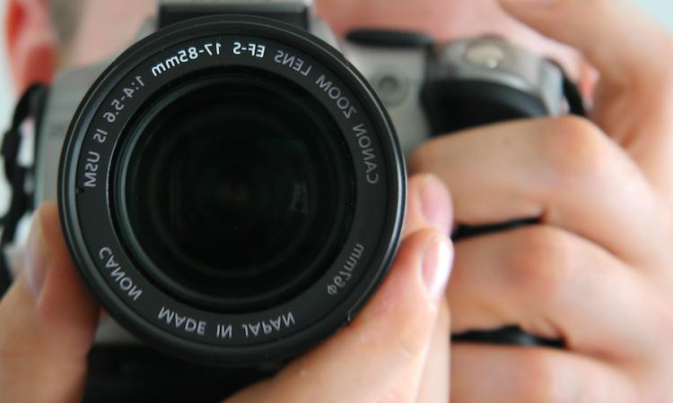 Man using 35 mm SLR camera