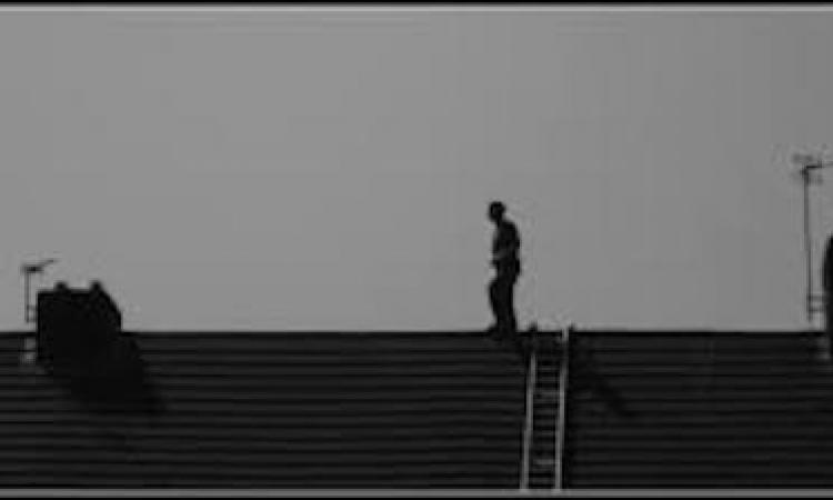 Man walking on roof