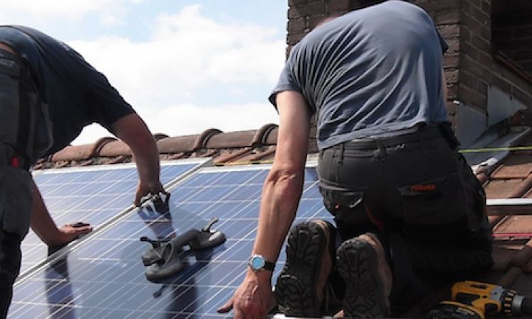 Solar installers working on roof