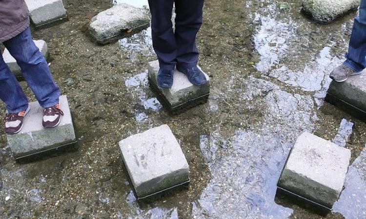 taking steps to make big improvements in your business—image of standing on stepping stones