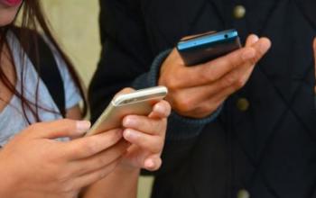 smartphones in hands of male/female