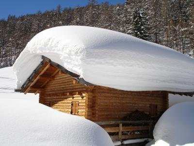 The snow on this roof is several feet deep, but how much snow is too much for a roof and threatens roof collapse?